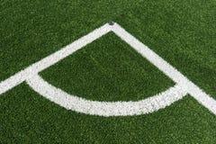 Corner lines of football field on plastic green Royalty Free Stock Photo