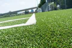 Corner lines of football field on plastic green Royalty Free Stock Photos