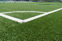 Corner lines of football field on plastic green Stock Photography