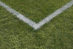 Corner lines of a sports field. Corner boundary lines of a green grass sports field stock photography