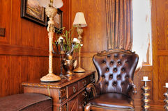 Corner of  living room in wooden decoration. Part of living room in wooden decoration and furniture, with fancy and elaborate style, shown as luxury, classical Royalty Free Stock Image