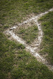 Corner local football pitch. Corner markings on muddy soccer pitch in park Royalty Free Stock Image