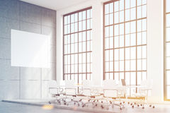 Corner of loft conference room with poster, toned Royalty Free Stock Photo