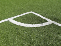Corner Marking on soccer field. Astroturf playing field with white corner marking Stock Photo
