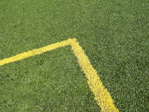 Corner Marking on soccer field. Astroturf playing fleld with yellow corner Royalty Free Stock Photography