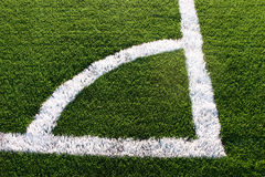 Corner marking on soccer pitch. Closeup of white corner marking on soccer or football pitch Royalty Free Stock Images