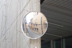 Corner mirror in a street of a village. Spain Royalty Free Stock Image