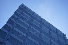 Corner of modern building in blue skies Stock Image