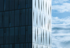 Corner of modern office building and cloudy sky Royalty Free Stock Photography