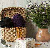 The corner of the needlewoman. Woolen threads for knitting winter things Stock Photos
