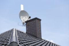 Corner of the new modern house. Corner of the new modern house with roof, chimney and TV antenna Royalty Free Stock Images