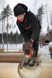 Corner notch, cutting and brushing for log cabin construction, u Royalty Free Stock Image