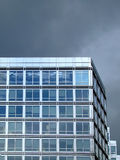 Corner of the office building. With stormy sky stock photo