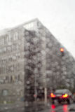 A corner of an office building at rainy day shot through a car window. Shot at a rainy day in Prague near Florenc and Karlin metro station stock photos
