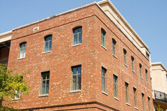 Corner of old Brick Building with Windows Stock Photo