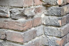 Corner of an old brick wall stock images