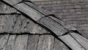 The corner of old cedar wooden shingle shake roof of the house stock footage
