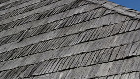 The corner of old cedar wooden shingle shake roof of the house Zoomed image stock video