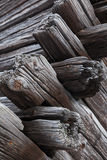 Corner of old dark wooden house made of logs Stock Photos