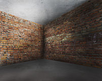 Corner of old dirty interior with brick wall Stock Photo