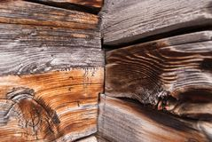 the corner of the old house is assembled from treated timber. texture of wood. Swiss Alps royalty free stock photos