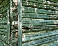 Corner of old weathered log cabin building royalty free stock photo