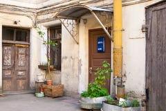 The corner of old yard. The corner of old yard in Saint-Petersburg. Door with blue post box royalty free stock photos