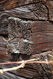 Corner of overlapping wooden beams on facade of ancient wooden farm house Royalty Free Stock Photo
