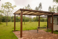In the corner of park, A pavilion and benches Stock Image