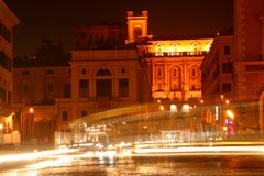 Traffic in night in Rome. Blurred cars and buses on a night shot in Rome, Italy Royalty Free Stock Photos