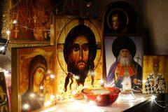 Corner for prayer. Russian traditional home church. Prayer to God. Icons illuminated by a garland. Jesus Christ. Ancient orthodox. Icon royalty free stock photo