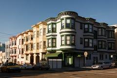 Corner of pretty neighborhood street in San Francisco bay windows. Corner of a pretty neighborhood street in San Francisco with three story apartment houses with stock photography