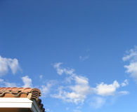 Corner of Real Estate and Sky. Corner of a house, blue sky, few clouds Royalty Free Stock Images