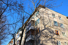 Corner of residential house opposite blue sky Stock Photo
