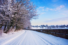 Corner of a rural road covered with snow Royalty Free Stock Image
