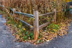 Rustic Wooden Fence Corner during Autumn royalty free stock photography