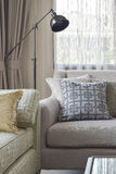 Corner seat with pattern pillows and black retro lamp Royalty Free Stock Photos