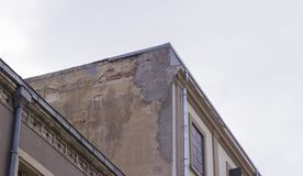 Corner shot of masonry old building under overcast sky in the morning stock images