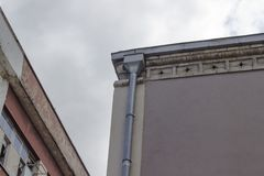 Corner shot of old painted building under overcast sky in the morning royalty free stock photo