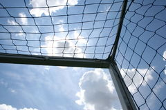 Corner shot of a soccer goal. Corner upward shot of a soccer goal with sky background Stock Photo