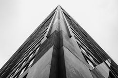 Corner of Skyscraper. Looking up the corner of a skyscraper building on an overcast day royalty free stock image