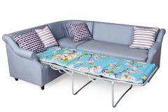 Corner sleeper sofa folding bed, upholstered in fabric light gra Royalty Free Stock Photo