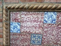 Corner of slightly skewed Front wall tiles in Andalusian Village. Closeup of Wall tiled with colorful ceramic tiles in village in Andalusia Royalty Free Stock Photos