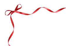 Corner with small red silk ribbon bow Stock Photos