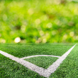 Corner of a soccer field and green bokeh Stock Images