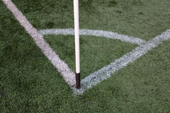 Corner of a soccer field. White markings on a green lawn at the corner of the football field Stock Photo
