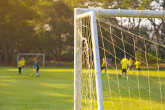 Corner of a soccer or football goal post with warm morning light Royalty Free Stock Image