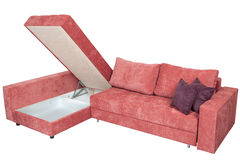 Corner sofa-bed of pink with storage system,  isolated on white. Royalty Free Stock Photos