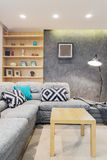 Corner sofa with patterned pillows Royalty Free Stock Photo