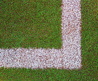 Corner on the sport arena. Lines on the sport grass field Stock Photos